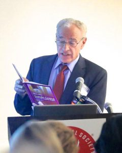 Dr. Goodman reading a passage from his textbook.